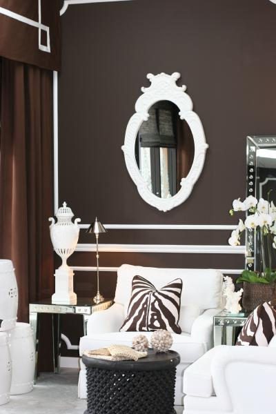 Brown walls, brown and white zebra pillow, white mirror, white chair; Room designed by Washington DC interior designer Decor Dose on Fortique