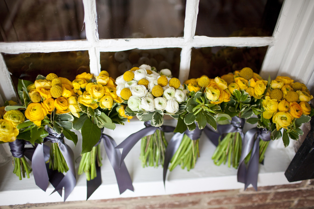 Beautiful yellow and white wedding bouquets with gray sash by Washington DC floral designer Kate Farrington of Rally & Root on Fortique