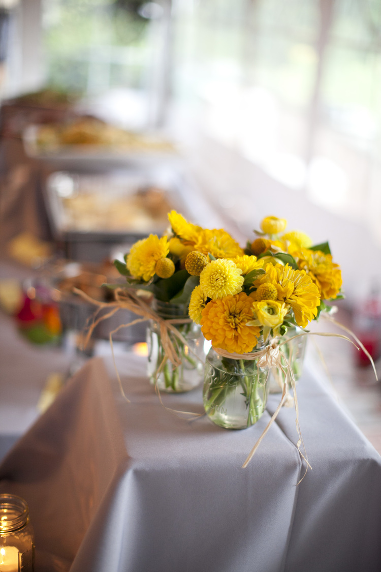 Sweet and simple rustic table flowers; yellow bouquet with mason jars and straw; floral design by Washington DC floral designer Kate Farrington of Rally & Root on Fortique