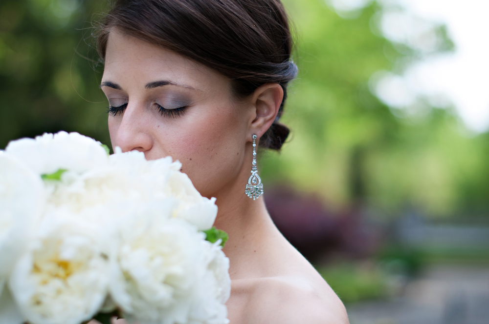 Pink and Gray eyeshadow.  Bridal smokey eye.  White bridal bouquet.  Silver drop earring.  Bride photograph.  Washington DC wedding makeup artist Julie Wardley