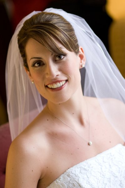 Striking smokey eye for brunette bride with updo and veil by Washington DC wedding makeup artist Julie Wardley