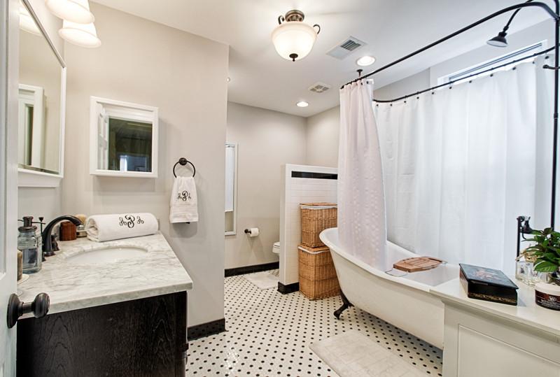 Clean black and white bathroom design; designed by Washington DC interior designer Olios Design on Fortique