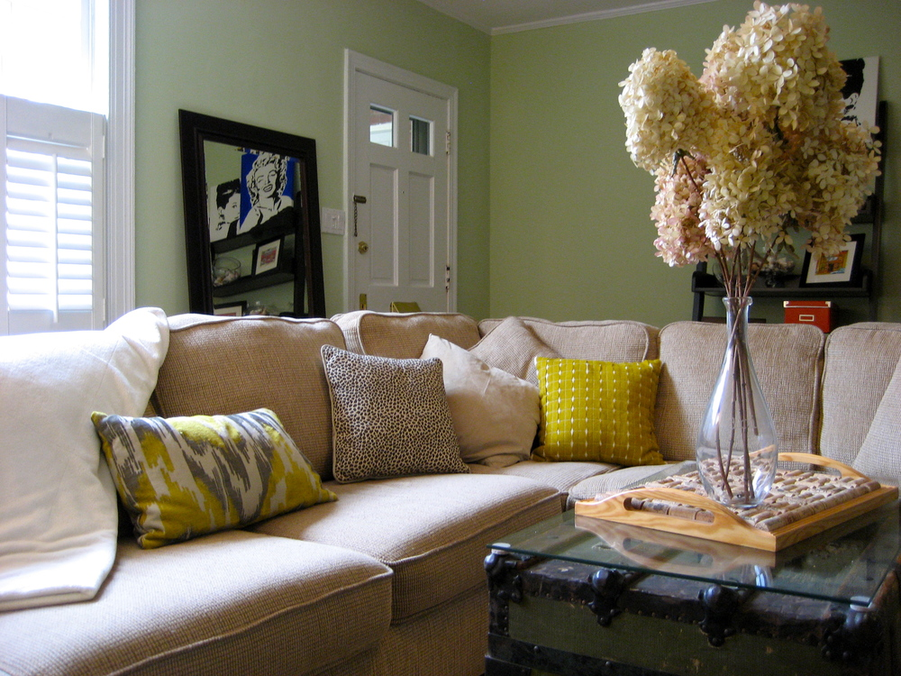 Yellow and Gray Family Room with ikat pillow; designed by Washington DC interior designer E. Fleming Design on Fortique