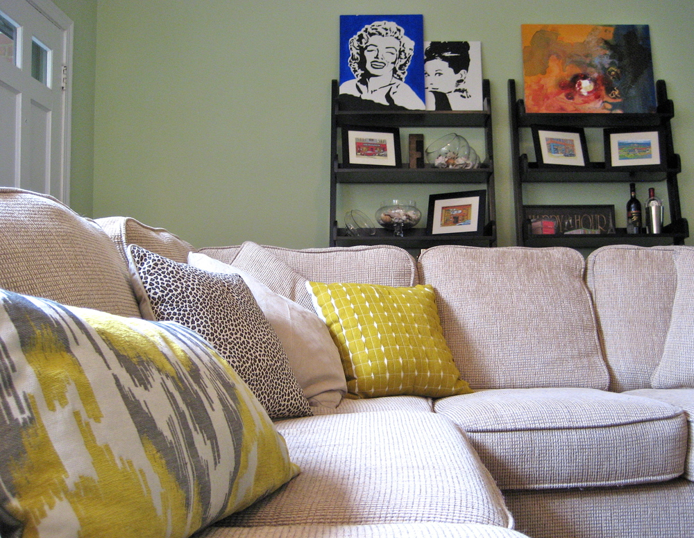 Yellow and gray family room design with ikat pillow; designed by Washington DC interior designer E. Fleming Design on Fortique