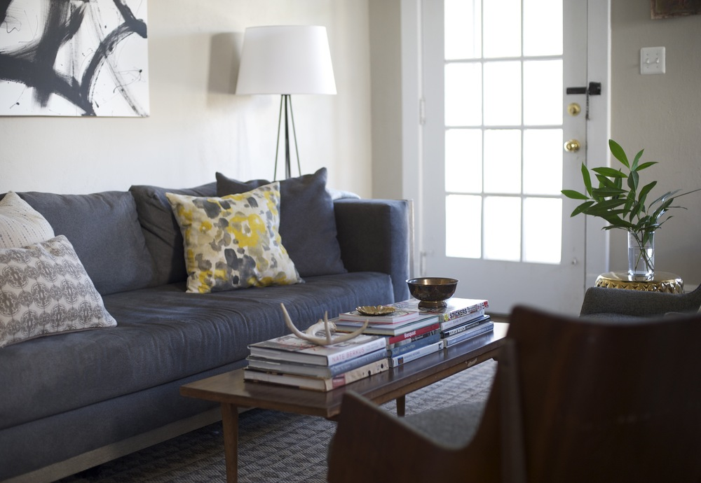 Yellow and blue gray family room design with floral pillow blue gray