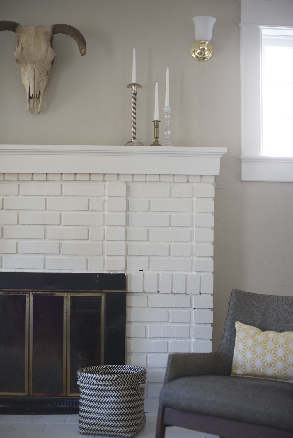Ram's head accent piece over fireplace; designed by Washington DC interior designer The Casa Pino on Fortique