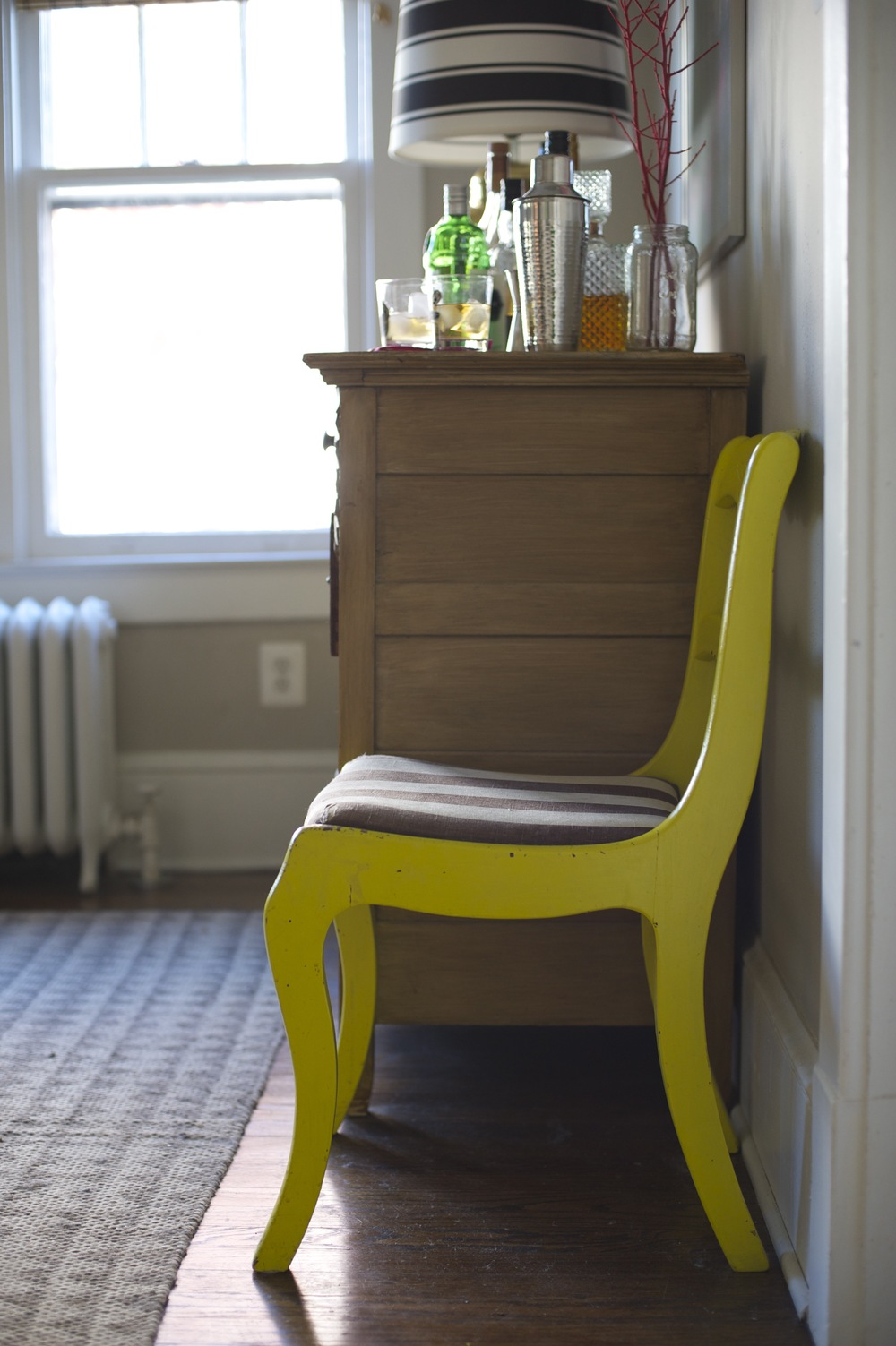 Neon yellow restored chair; designed by Washington DC interior designer The Casa Pino on Fortique