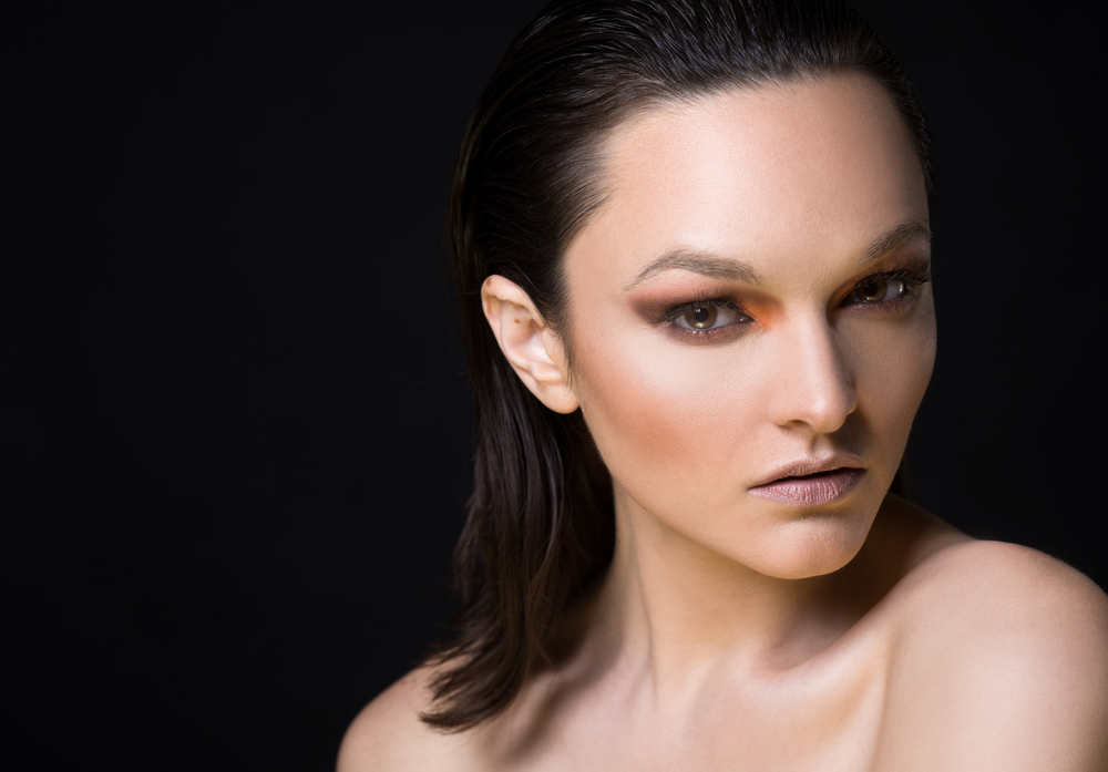 Stunning fashion shot with slicked back hair, orange, red, charcoal eye shadow; Photography by Washington DC photographer Cedric Terrell on Fortique