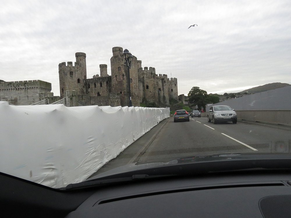 Entering Conwy - town walls to the far left, castle next to it and a large construction project under wraps - or maybe Christo is visiting.