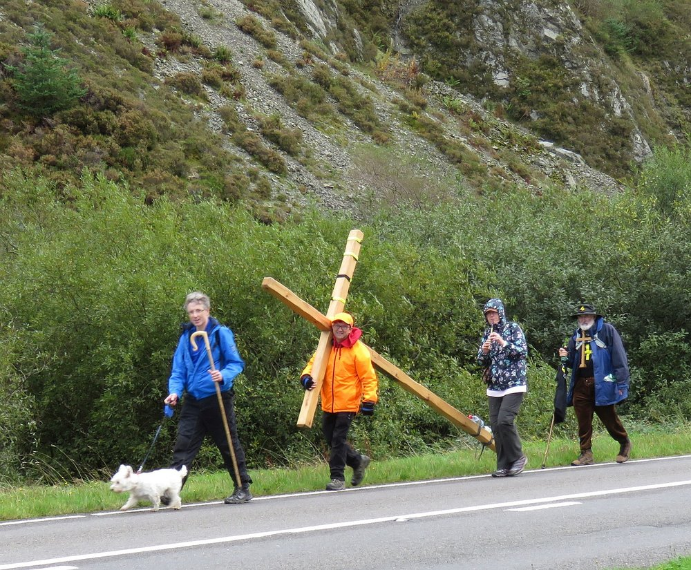 Man walking across Wales with the Cross