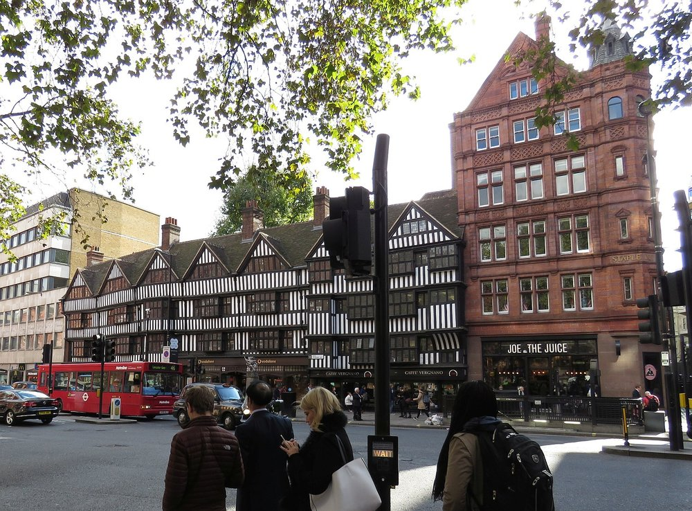 Staple Inn, built in mid 16th Century and still in use on Holborn Street.  Originally lodging for visiting wool merchants (staplers), it became an inn for law students.  Today, it's offices.