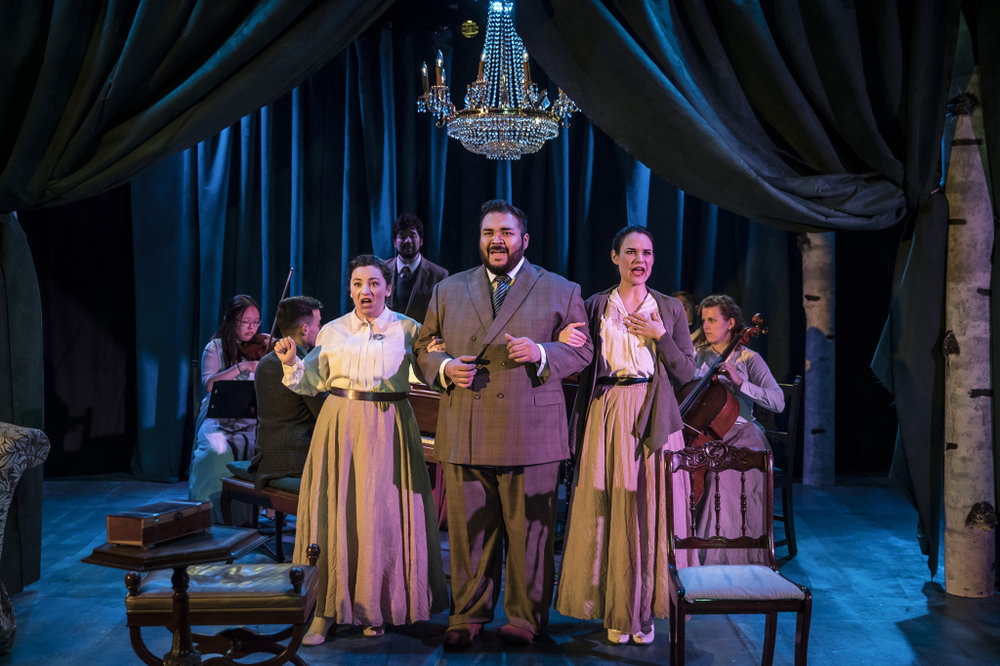 "Rachel Klippel (from left), Lazaro Estrada and Emily Goldberg in a scene from BoHo Theatre's production of ""A Little Night Music.""  Note the quartet of musicians behind."