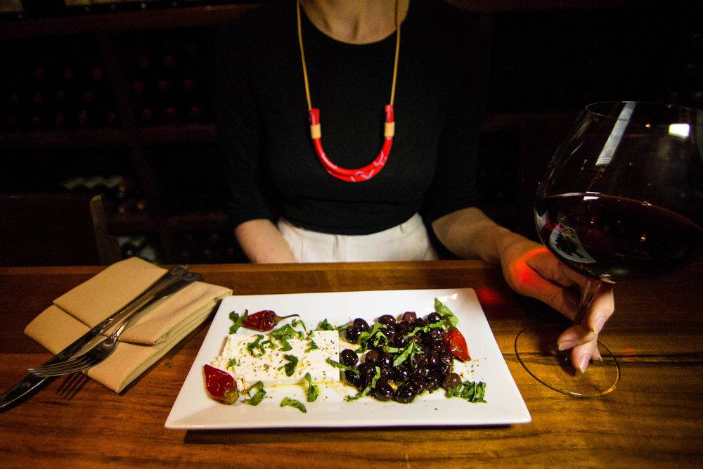 Woman enjoying her meal inside a wine bar