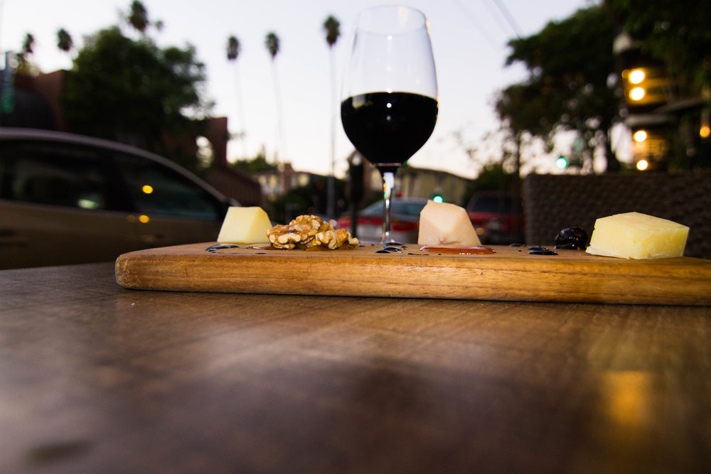 Wine and cheese board outdoors