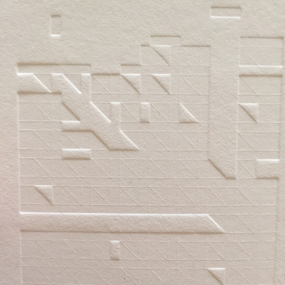 This blind impression pattern is a great example of the impact that the negative space left in a design (and therefore in the photopolymer plates) has. The fine lines that make up the lighter pattern were created by thinner breaks in the plate, and the larger areas of relief are wider breaks in the plate. Obviously, the wider areas were able to allow the paper to expand and have a deeper impression.