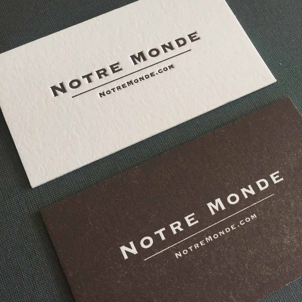 The original design for the Notre Monde cards was their logo knocked out of a flood of color, but they were wanting a deeper impression. By simply reversing the design and printing the positive (as opposed to the negative area), we were able to give them the deeper relief they were seeking. Designed by Notre Monde.