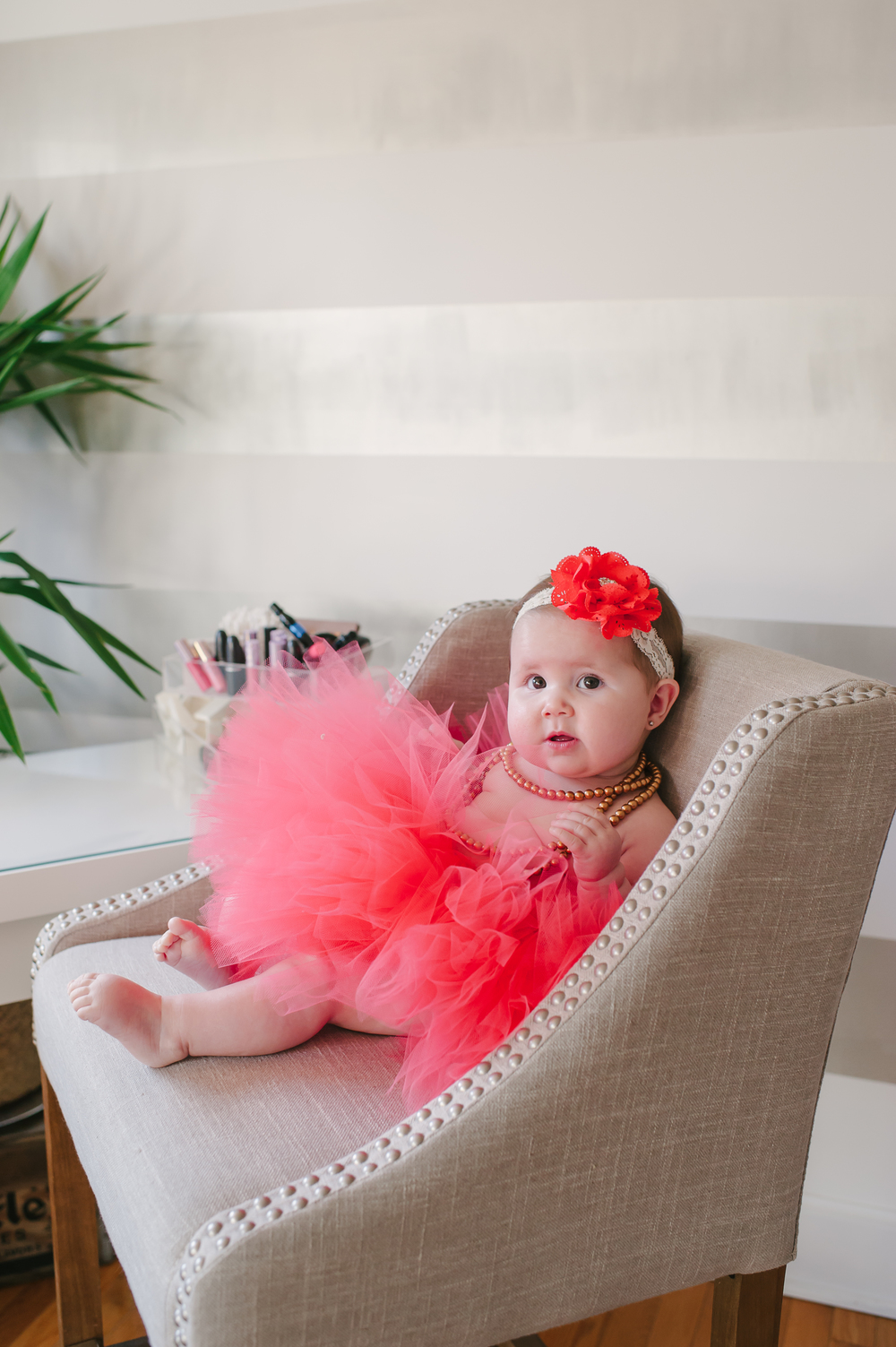 Addison Amy sitting in mommy's makeup chair  Photo Credit:  Brooke Allison Photography