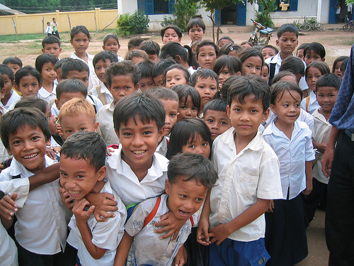 "This photo of Cambodian school children was posted online with a request for $10 donations to a respected organization in order to ""send a child to school."""