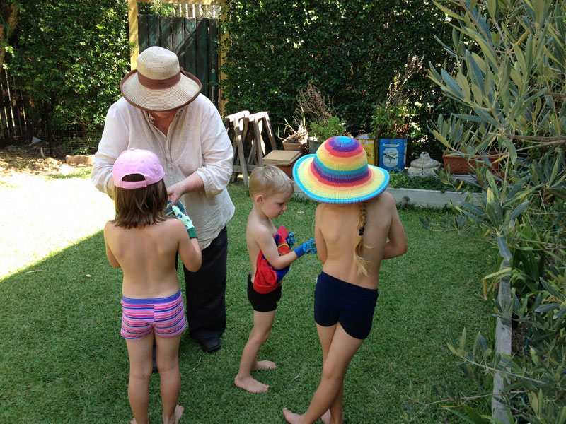 Gardening with Nana. No, we can't make them wear much more than shorties!