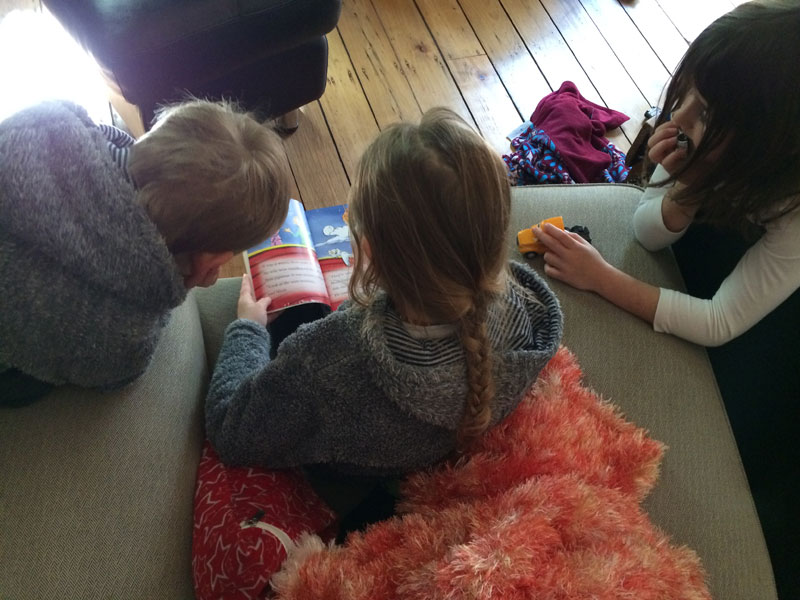 Zoe reading to her siblings. Something that I want to happen every day!