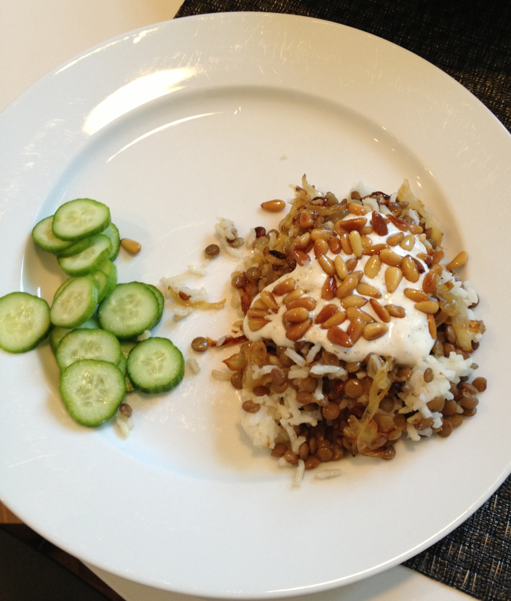 Mujadarra with yogurt sauce, toasted pine nuts, and cucumber rounds