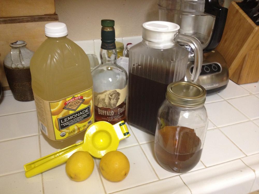 The ingredients (from left): lemonade, lemons, bourbon, iced tea, simple syrup