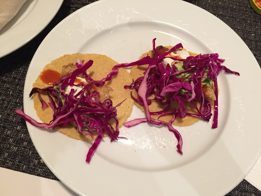 Fish tacos with guacamole, lime crema, tapatio  hot sauce, and red cabbage slaw