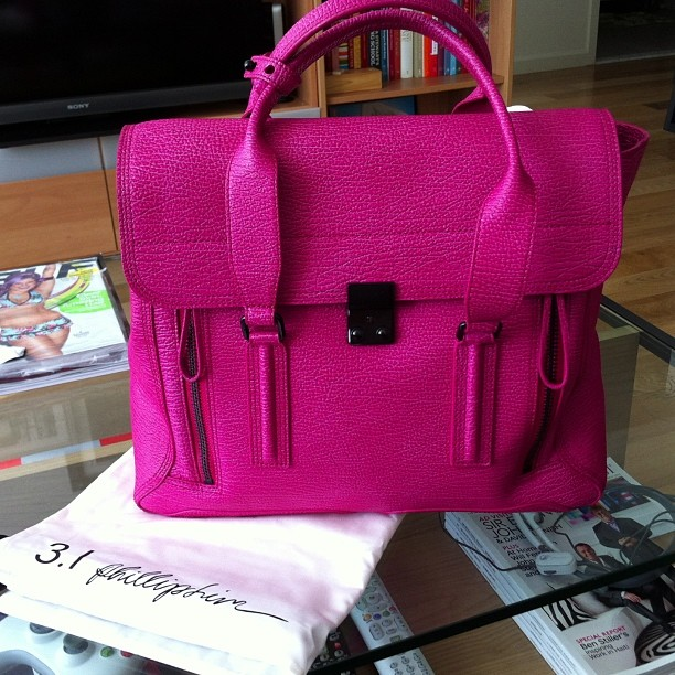 Treated myself to a gorgeous fuschia 3.1 Phillip Lim Pashli satchel and haven't stopped wearing it since. They no longer carry this color, but they do have one in Coral.