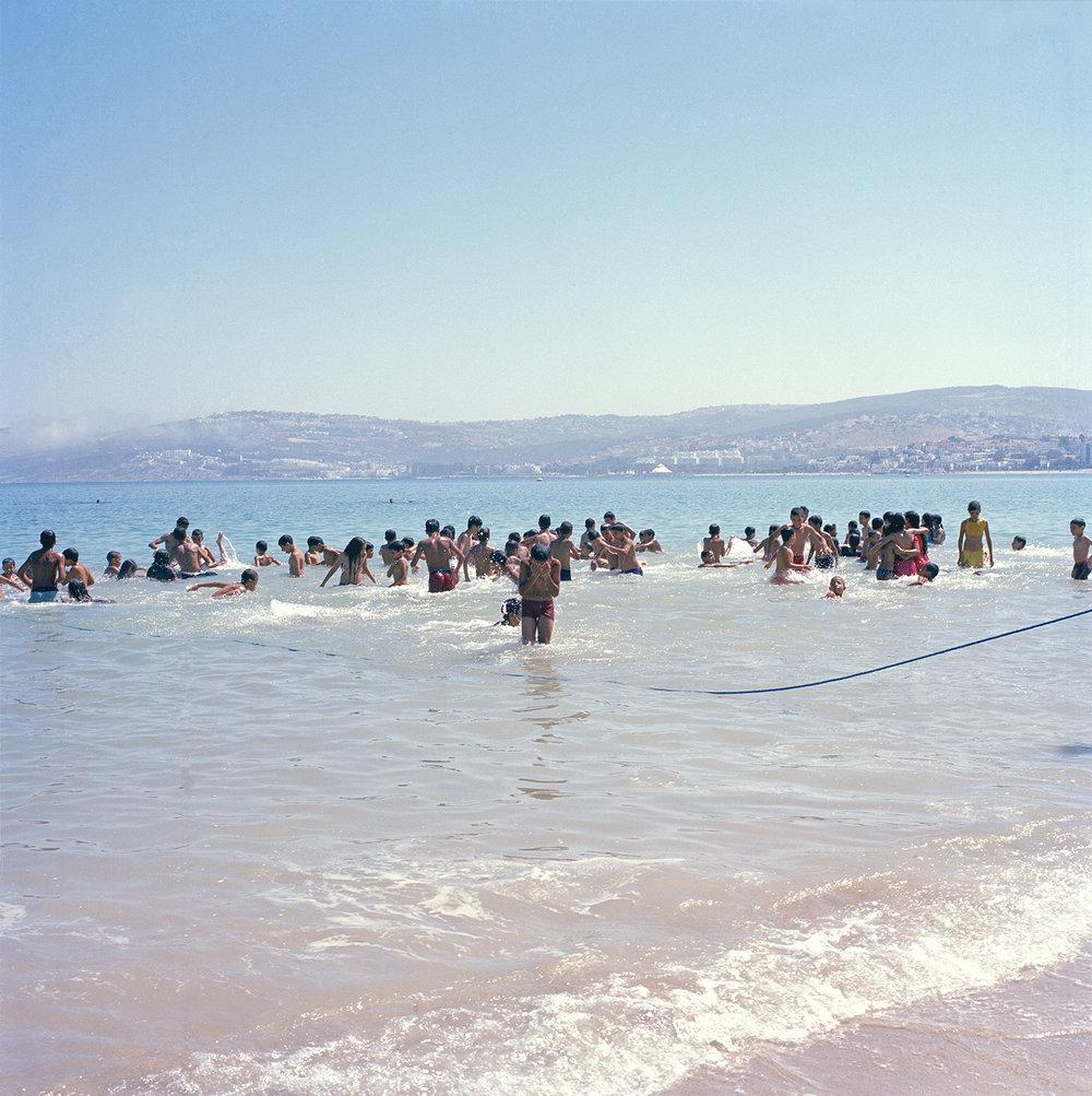 YM_Tangier_Kids playing in water in rope_wksp.jpg