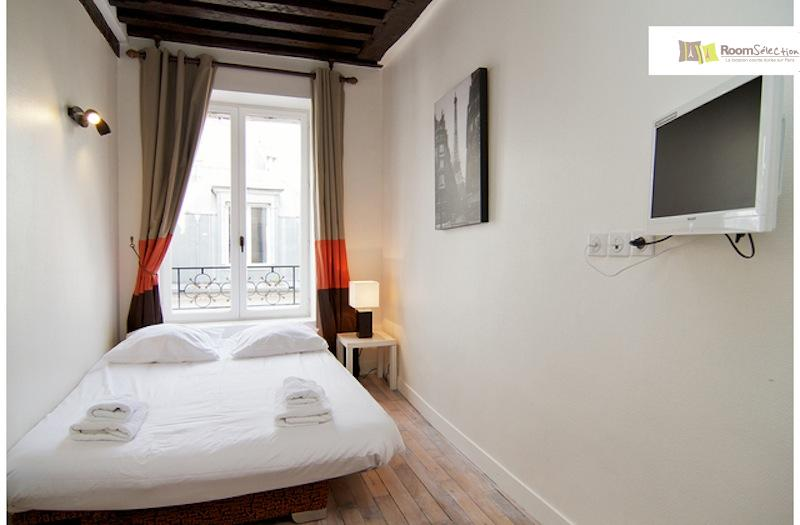 Our teeny apartment in Le Marais, Paris. Photo taken by Room Selection.