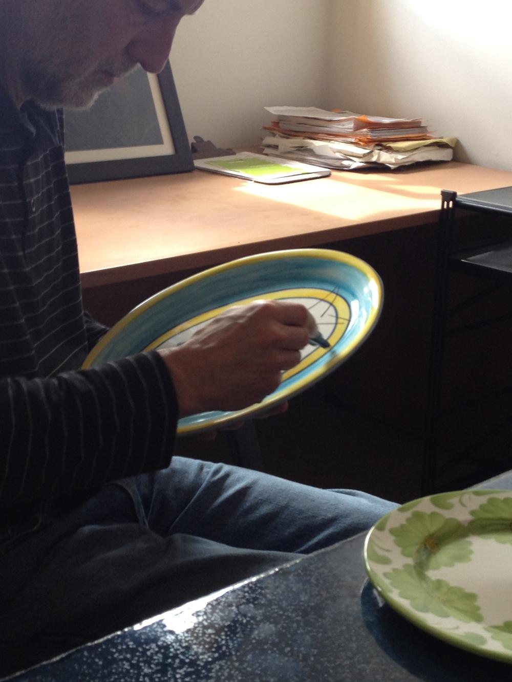 José Ignacio Adjusting the Platter Decoration