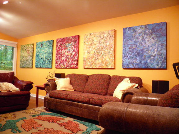 Five of twelve canvases on display and 26 paintings all together.