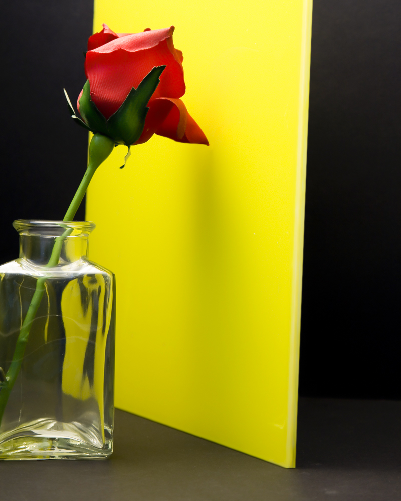 Yellow glass with flower