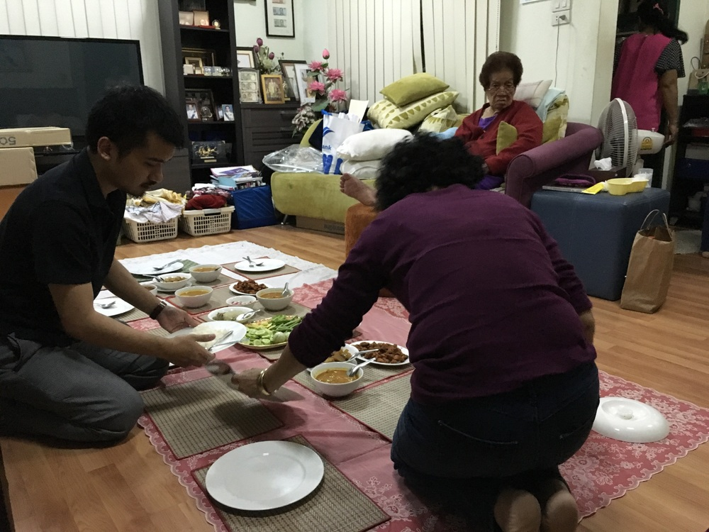 A really lame pic of grandma's house. I wasn't in the picture taking mood.  We always eat together on the floor. That's mum and my cousin preparing the serving. Amazing food.