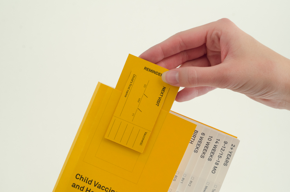 The Reminder card being placed on the health record.