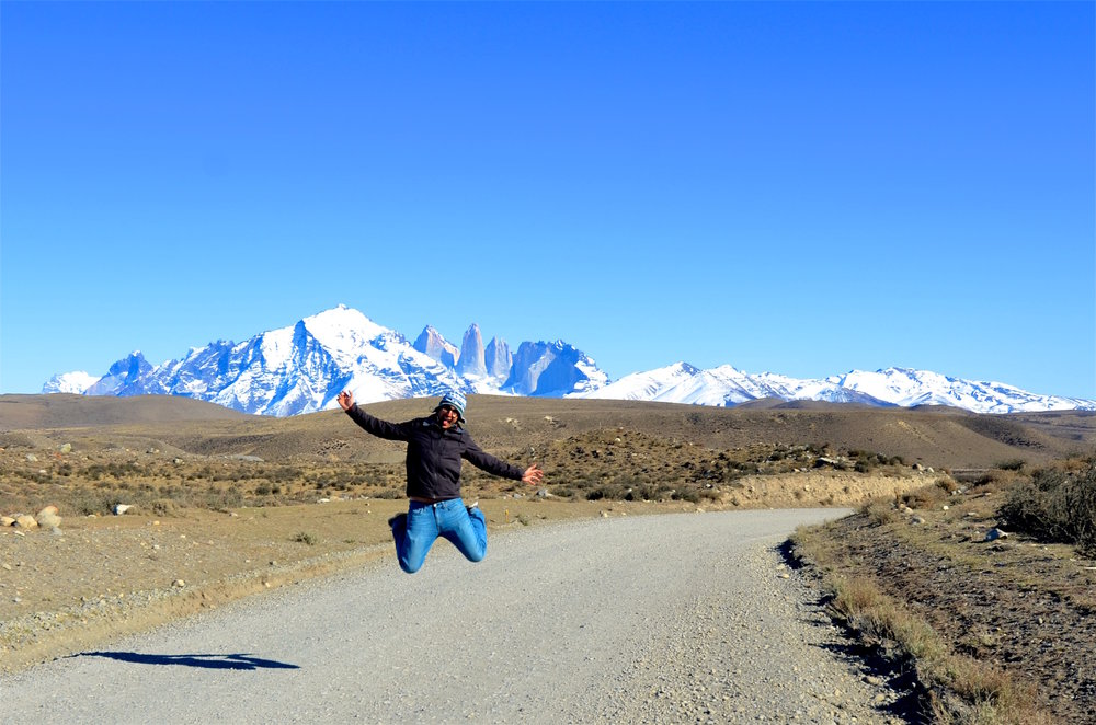 Jumping for joy at the end of the world in Patagonia, Chile.