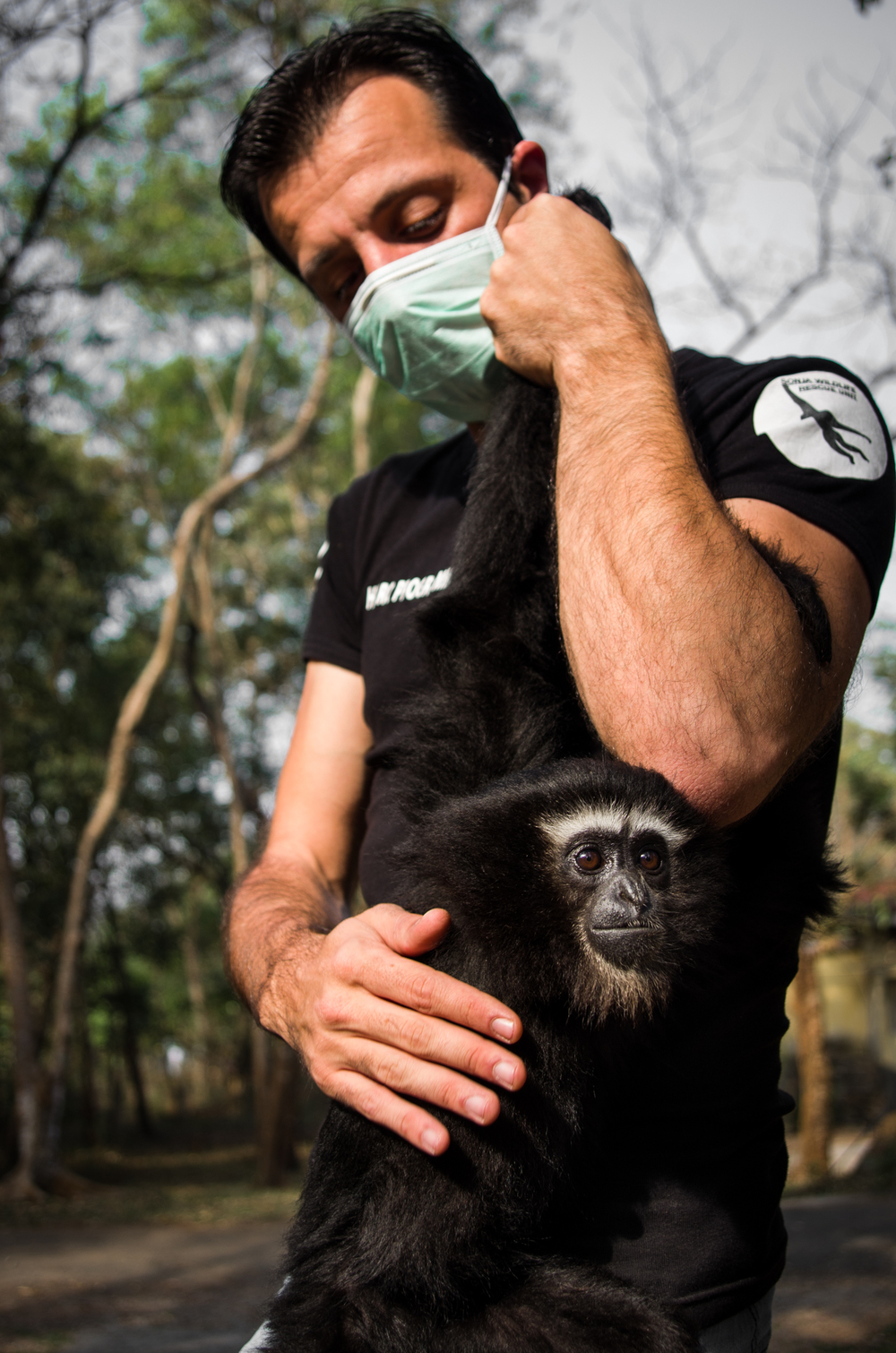 Florian Magne, founder of Huro Programme, with Luna.  Luna is the youngest and most recently rescued gibbon.