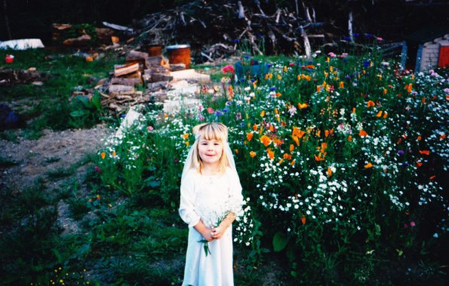 """Kelly, my little sister, in her favorite outfit at the time, playing the """"bride."""""""