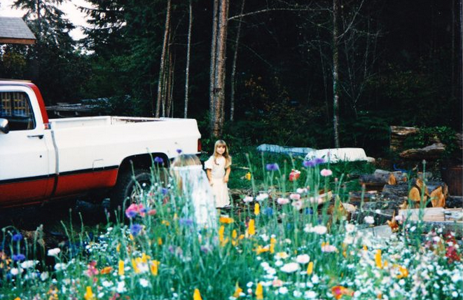 Messing around in the wildflowers that overtook our front yard for the first couple of years after we moved to this house.