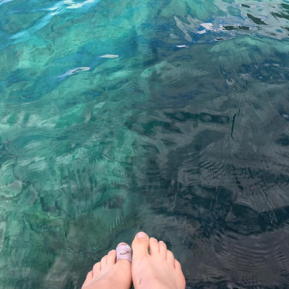 Feet in Lake Crescent's special gem blue water.