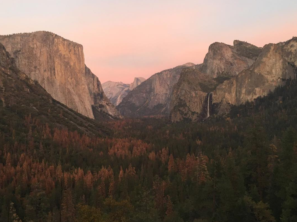 Tunnel view at sunset with Bridalveil Falls flowing on the left.