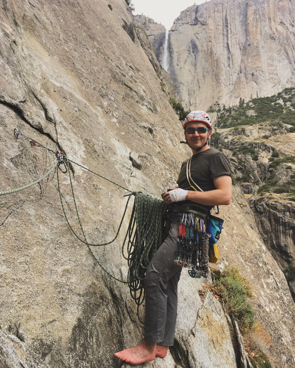 My babe hanging out on the wall at one of the pitches with Yosemite falls in the background.