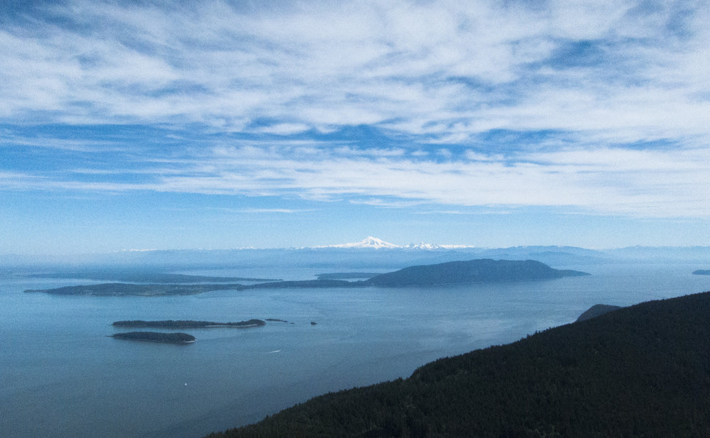 View of Mt. Baker, Cascades, Canada, Bellingham and San Juan Islands from Mt. Constituion Lookout.