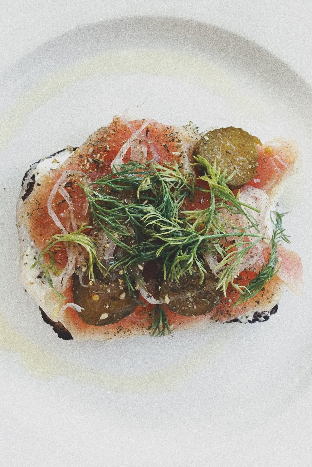 Lunch at the London Plane. Local smoked salmon on labneh with pickled red onion, cornichon and dill.