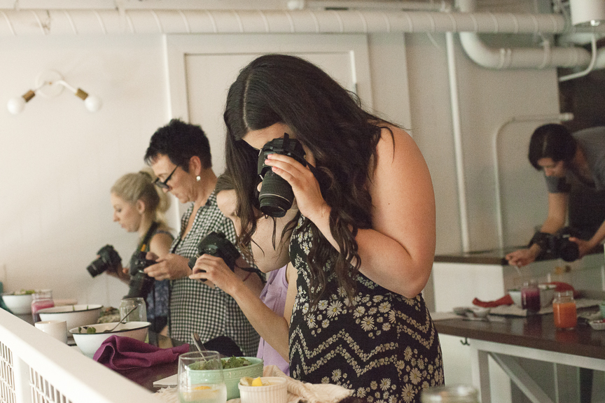 Students photographing sweetgrass food in the Sweet & Honest Workshop. Photo by: Anne Marie Zarba