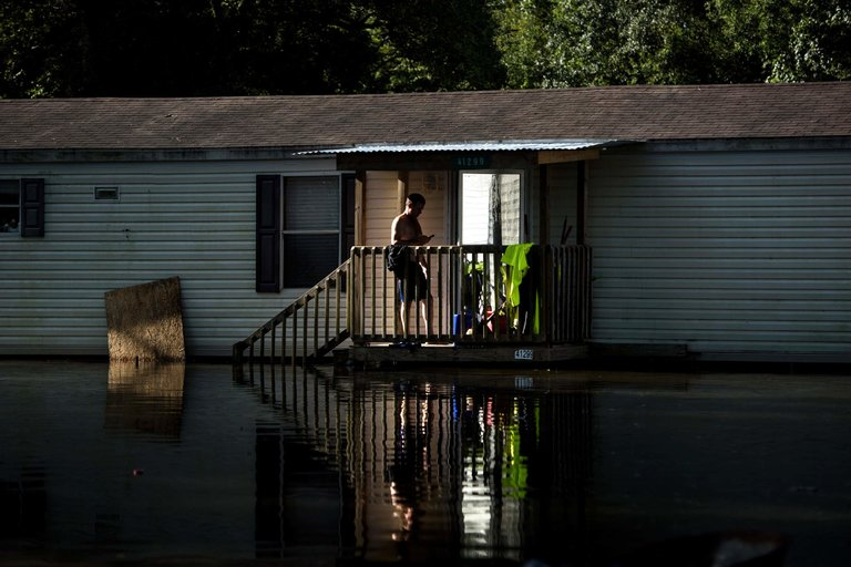 A home surrounded by floodwaters on Tuesday in Gonzales, La. Photo: Brendan Smialowski / Agence France-Presse.