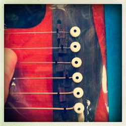 make acoustic guitar play in tune