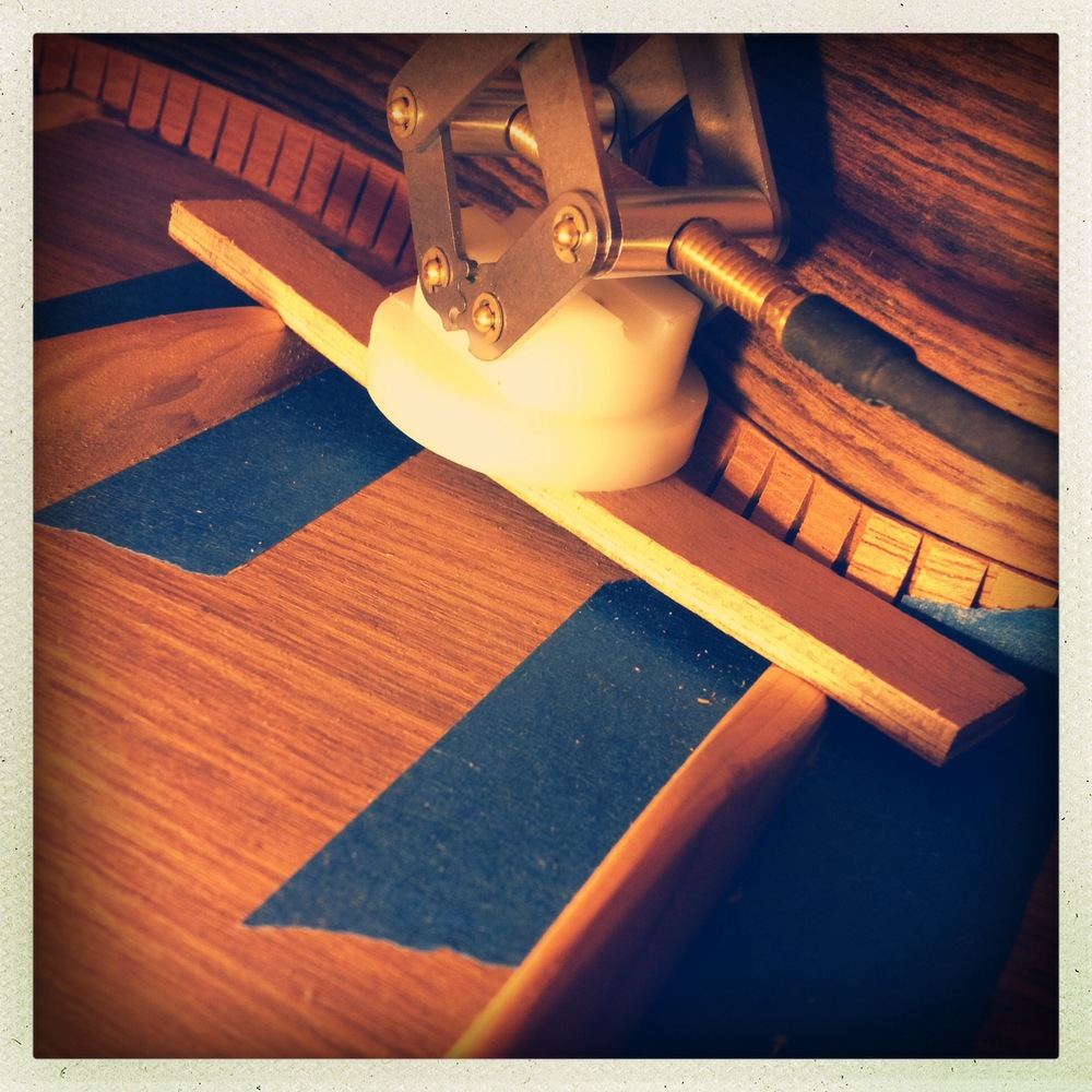 Glueing and clamping loose back brace on acoustic guitar