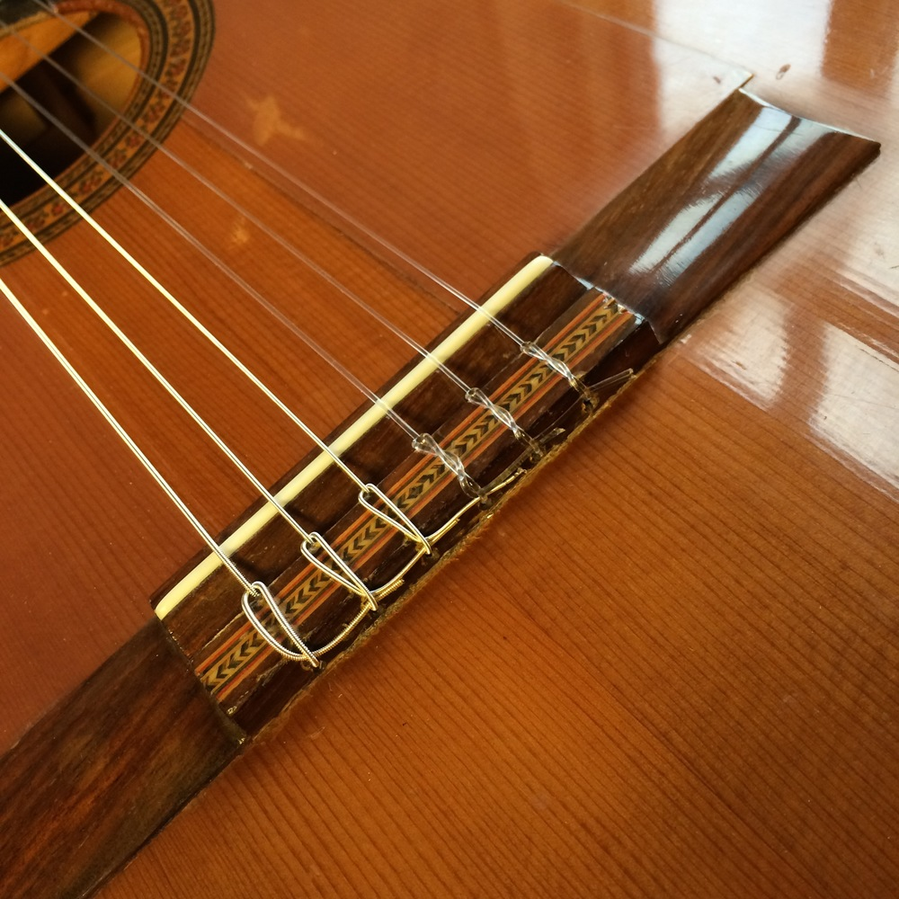 Restringing a nylon string guitar - nice neat job