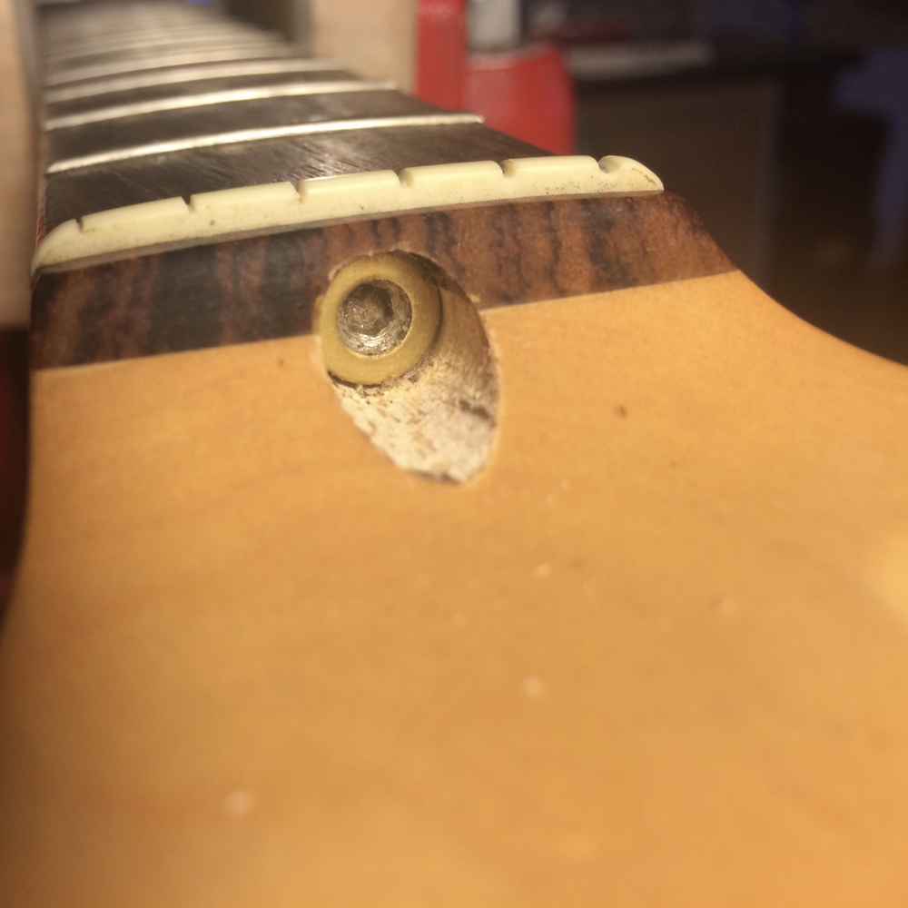 The washer sits between the Fender truss rod nut and the (now removed) wooden plug